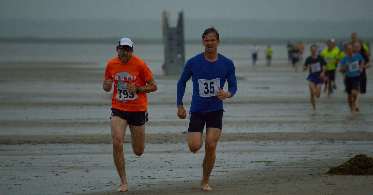 Suur pildigalerii: aastajooksjad kolisid rannaliivale ja lippasid äikse ja paduvihma kiuste